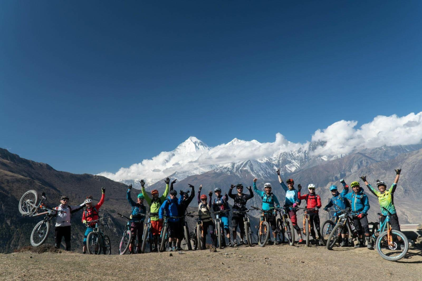Mountain Bikers in Front of Mountain Range