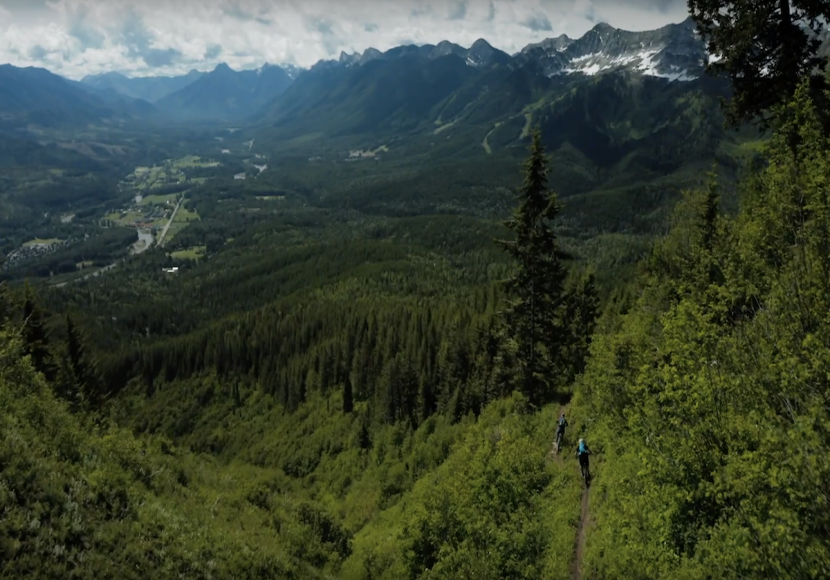 View from above the beautiful landscape and mountains of British Columbia, the location of our Rocky Mountain Rambler mountain bike tour.