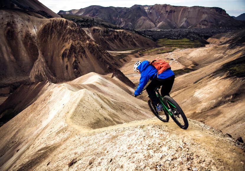 Mountain Biker riding across hill ridges in Iceland