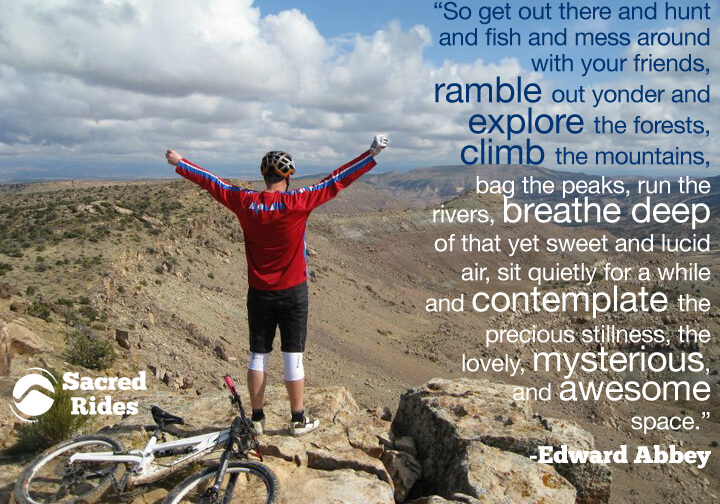 Man standing on a rock with a long quote by Edward Abbey about getting outside into the great outdoors.
