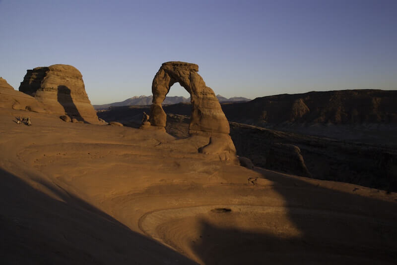 Two large stone arches on sandstone terrain in Arches National Park in Utah